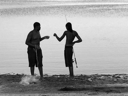 fish fishing lassing sunset friends black white monochrome beach tampa bay salty gulf bait cast net casting moment story dinner documentary