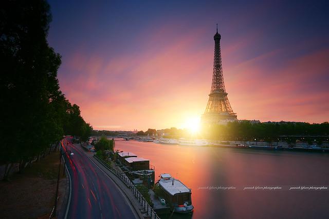 Sunrise behind the Eiffel Tower - Paris / France