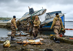 ADAK, Alaska (Sept. 2, 2019) Master Diver James Ohalek of Mobile Diving and Salvage Unit One (MDSU 1) removes pieces of the pilothouse during dismantling of the F/V Heritage, an abandoned vessel that had been blocking access to a boat ramp on Adak Island in Alaska's Aleutian chain. MDSU 1 is on Adak in support of Arctic Expeditionary Capabilities Exercise 2019 and is the U.S. Navy's premier diving and salvage force that is prepared to rapidly deploy combat-ready, expeditionary warfare capable, specialized dive teams to conduct harbor and waterway clearance, emergent underwater repairs and salvage operations in all environments. (U.S. Navy photo by Senior Chief Mass Communication Specialist Brandon Raile)