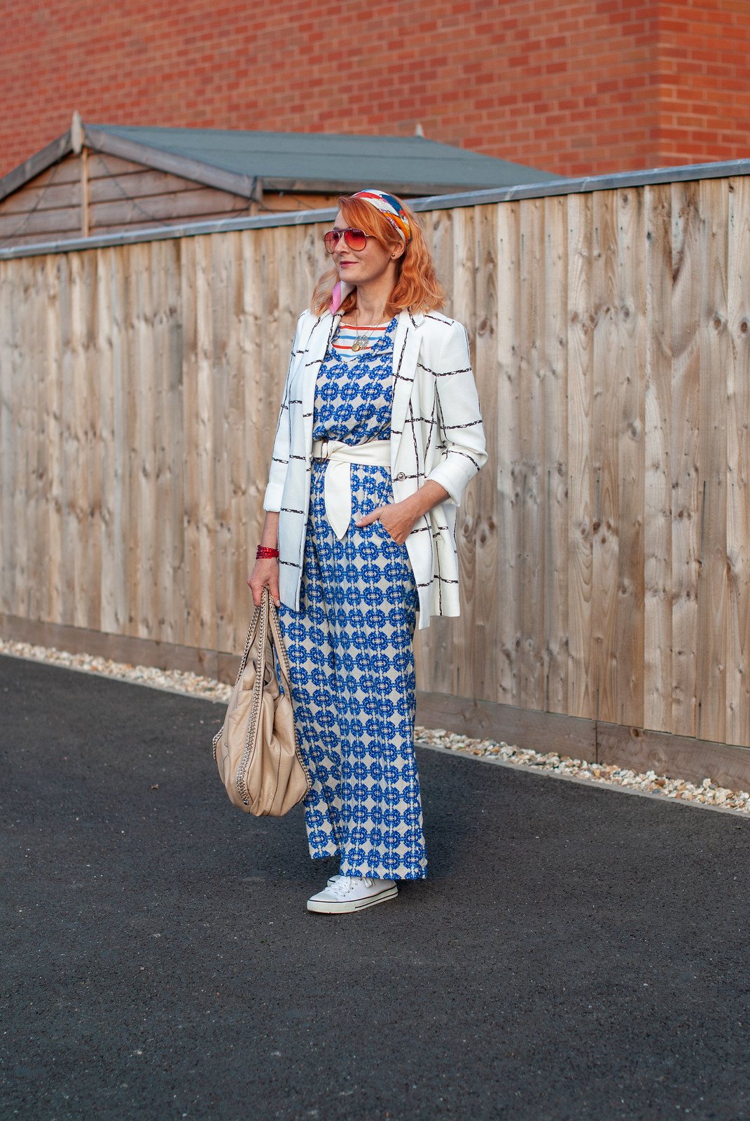 Styling a Summer Jumpsuit in Autumn With Serious Pattern Mixing: Blue patterned jumpsuit, black and white windowpane check jacket, white tennis shoes | Not Dressed As Lamb, over 40 fashion blogger