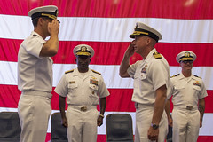 Capt. Luke A. Frost, right, exchanges a salute with Capt. Daniel A. Nowicki during the change of command ceremony aboard USS America (LHA 6). (U.S. Navy/MC3 Vincent Zline)
