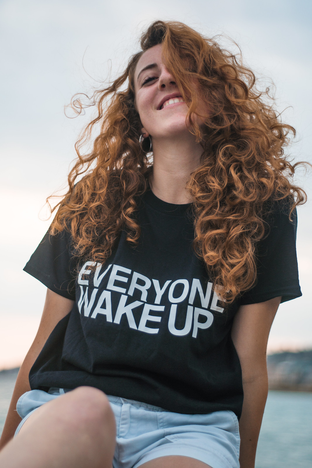 a photo of a girl in Everyone shirt