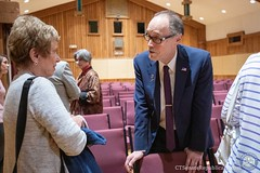Rep. O'Neill talks with a constituent following a round table discussion featuring Governor Lamont at Heritage Village in Southbury Monday morning.