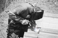 DOC welding on a brace for boarder fence July 2008 JTFN near P.O.E Columbus,NM.(NMCB-21) CAN-DO!