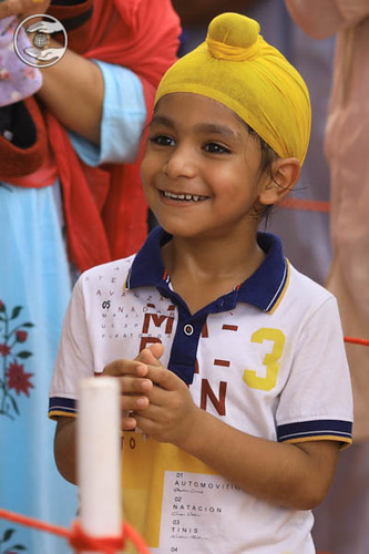 A child devotee delighted on seeking blessings
