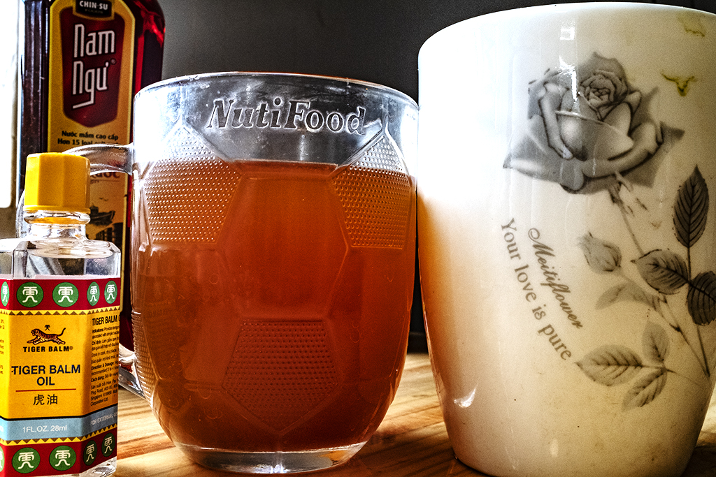 Tiger balm and instant noodle broth in a beer mug--Ea Kly
