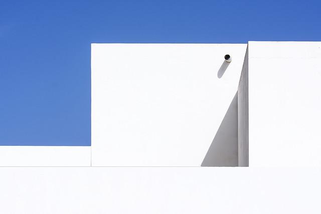 Rain pipe and white walls