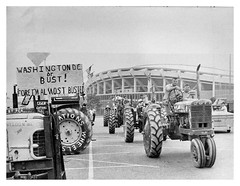 Farm vehicles park at RFK stadium during price protest: 1969