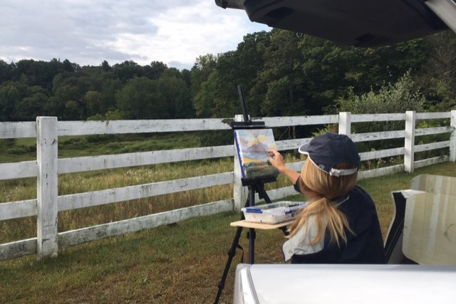 Blanche Serban of Mansfield is doing a year of plein air painting on Horsebarn Hill. She has three months to go. Photo by Camilla Crossgrove.