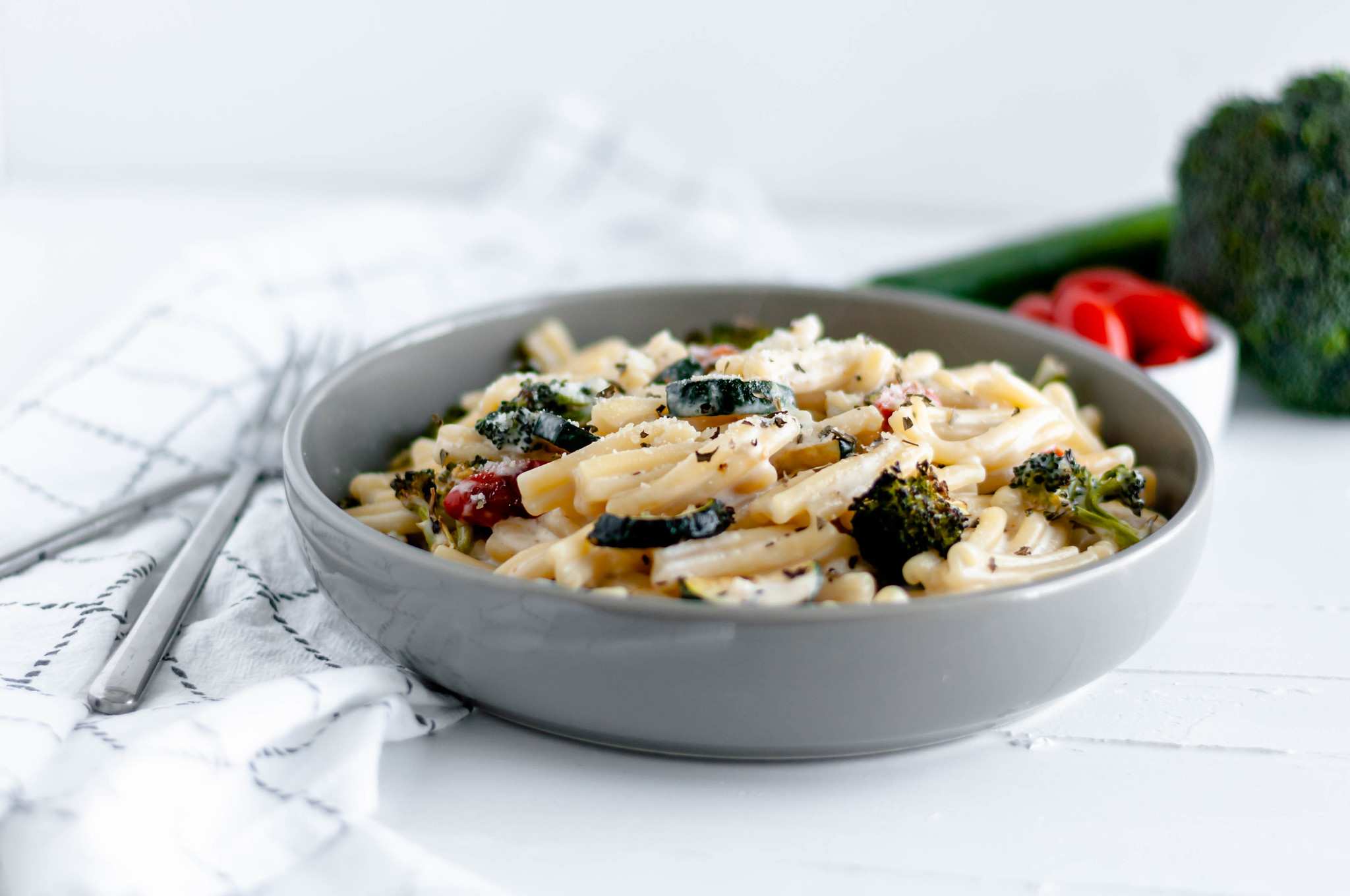 This Creamy Roasted Vegetable Pasta is a fast dinner option packed with flavor. Cheesy, creamy sauce, perfectly cooked pasta and flavorful roasted veggies.