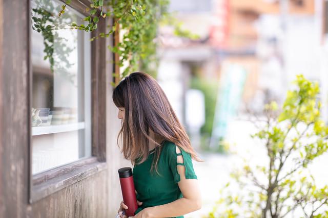 Young woman window shopping in Okinawa, Japan