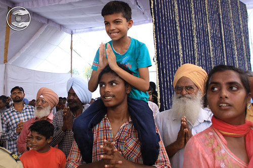 Child devotee delightfully seeking blessings