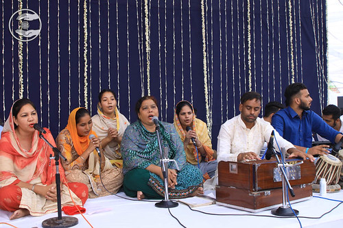 Devotees presenting a group song