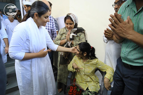 Her Holiness blessing the physically abled child