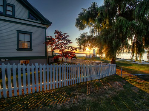 washingtonstate pacificnorthwest brownspointlighthouse sunset trees whitepicketfence