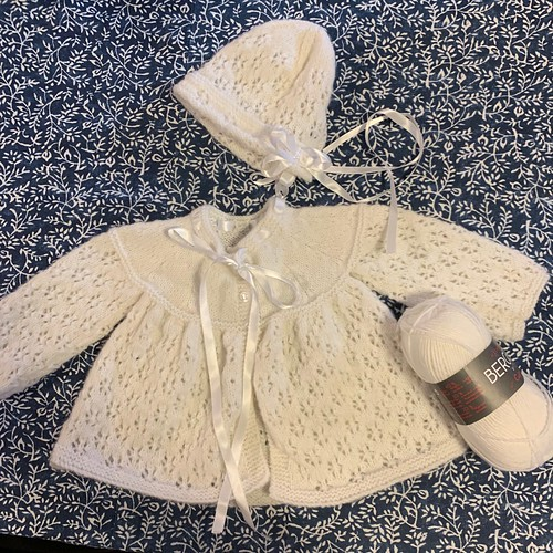 Sweet gifts for baby!!! A little Cardi and bonnet that Linda knit using Bergere de France Caline