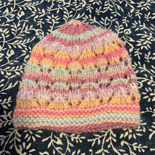 Heidi finished this cute baby hat using Sirdar Snuggly Baby Crofter DK to gift to the same babies as her mom Linda!