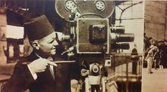 Thrills For A Living -  Charles Peden - Red fez is in order when photographing a King of Italy's visit to a King of Egypt, Movie Mirror February 1938