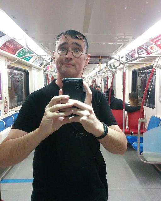 Rain-soaked selfie in the mirrored subway door, Davisville station #toronto #ttc #subway #davisvillestation #me #selfie #mirror #rain