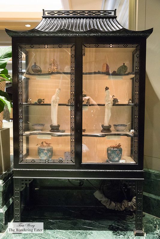 Display case of antique Chinese art work