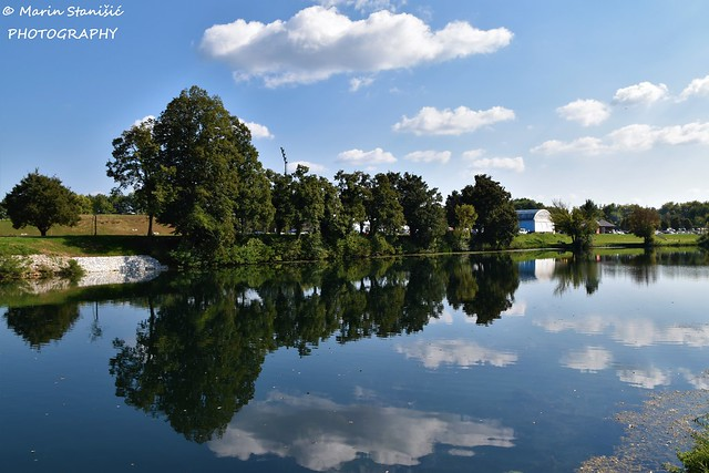 Karlovac, Karlovac County, Croatia - Reflection&floating clouds on river Korana