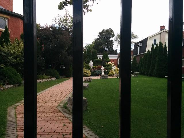 Gated garden #toronto #highparknorth #azielstreet #annettestreet #stcecilia #romancatholicism #gardens #gate