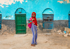 Portrait of a somali young woman in the streets of the old town, Sahil region, Berbera, Somaliland