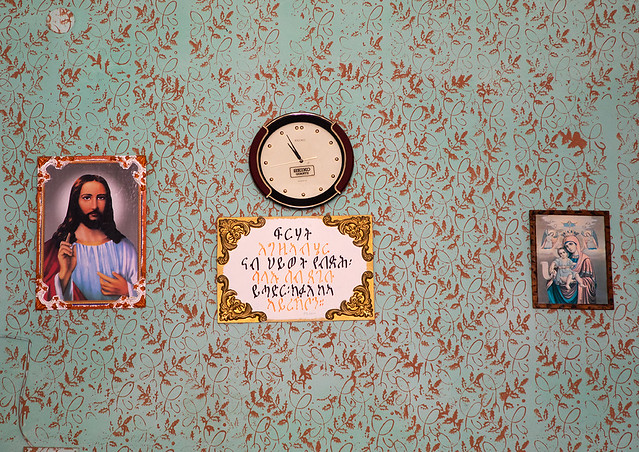 Religious decorations on a wall in a shop, Central region, Asmara, Eritrea