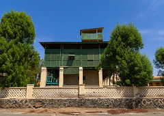 Old colonial building with green wooden balcony, Northern Red Sea, Massawa, Eritrea