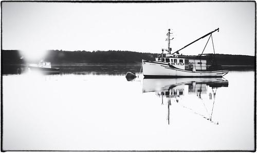 sunset blackandwhite bw blackandwhitesunset boats harbor lubec maine me fineartphotography blackandwhitephotography photography seascape coastalnewengland newenglandphotography coastalmaine unitedstatesofamerica