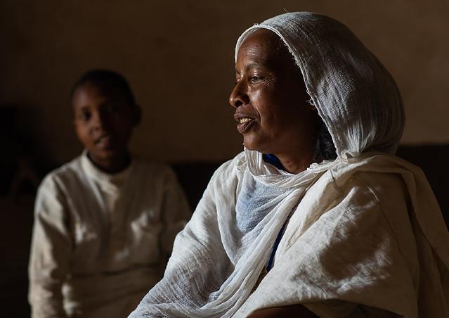 Eritrean orthodox woman and son in traditional clothing, Central region, Asmara, Eritrea