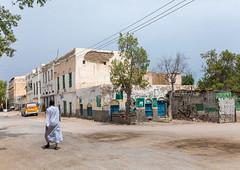Somali man walking in the old city, Sahil region, Berbera, Somaliland