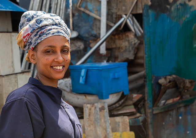 Eritrean woman working in the Medebar metal market, Central region, Asmara, Eritrea