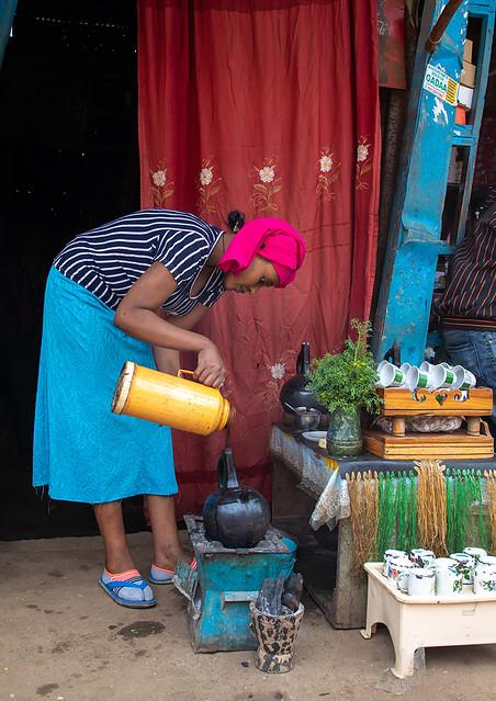 Ethiopian woman preparing coffee in a bar, Harari region, Harar, Ethiopia