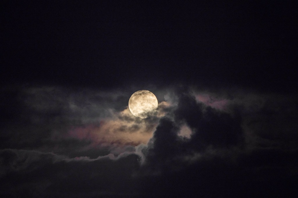 Full Moon Rising through the Clouds