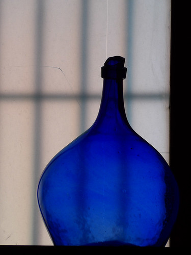A back-lit blue glass vase in an art gallery in Puebla, Mexico