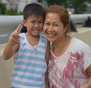 mother and son on a pedestrian bridge