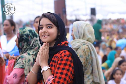Devotee seeking blessing delightfully
