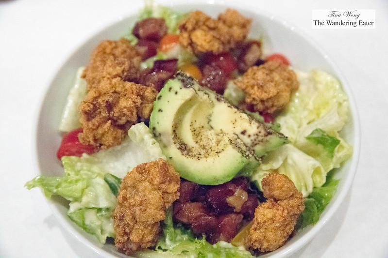Fried oysters salad, hearts of romaine, Benton's bacon, avocado, tomato, Caesar dressing