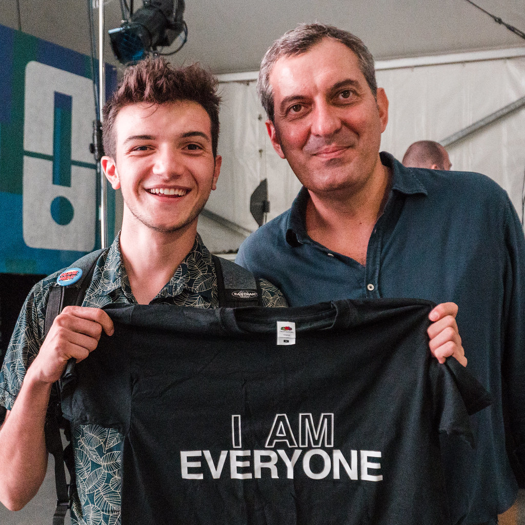 a photo of Mario Calabresi holding Everyone's shirt