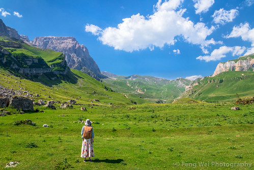 traveldestinations asia azerbaijan tourist female rearview tourism colorimage beautyinnature travel solitude eurasia caucasus outdoors laza scenicsnature horizontal mountain qusar caucasusmountains remotelocation landscapescenery youngadult journey exploration summer adventure mountainrange hiking