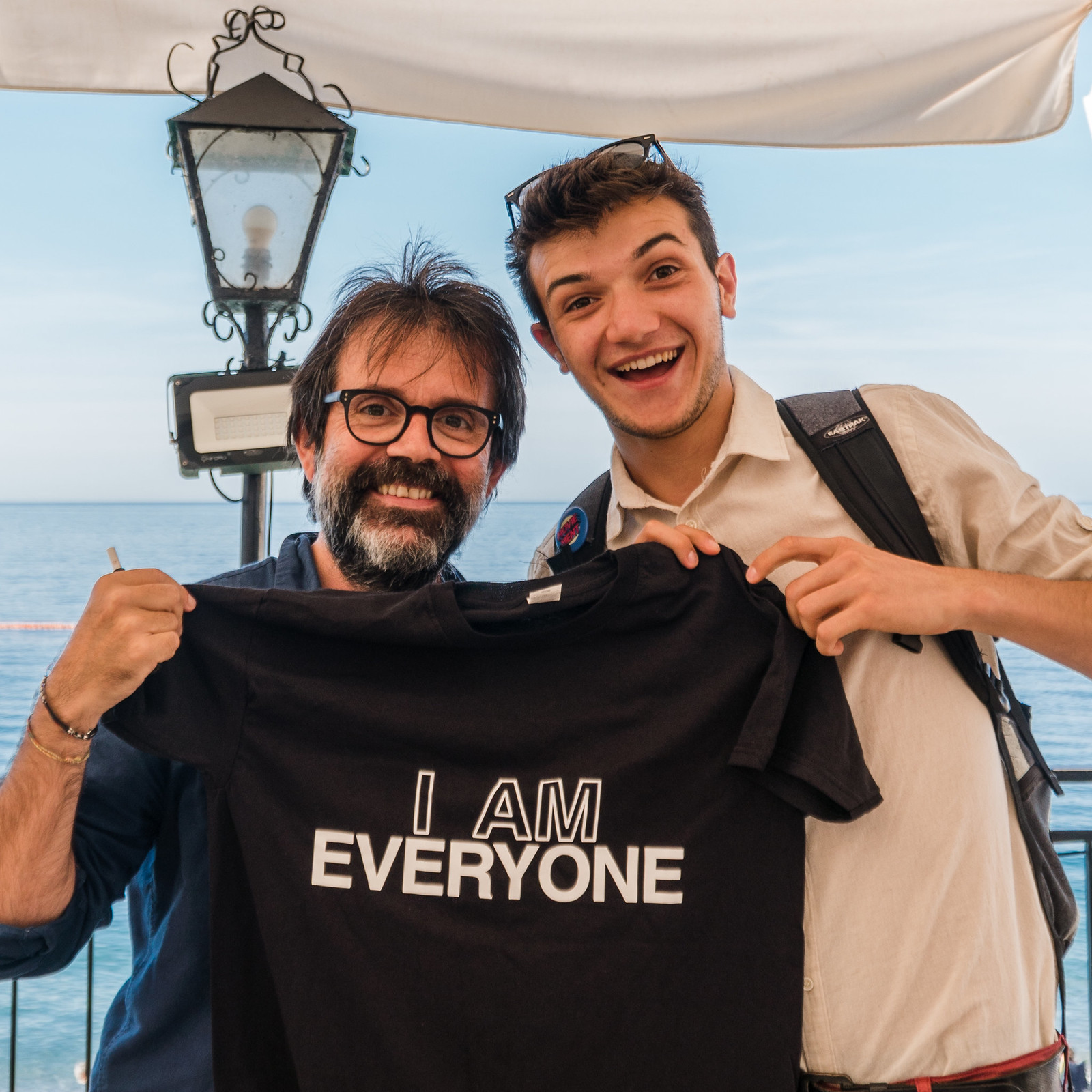 a photo of Guido Catalano holding Everyone's shirt