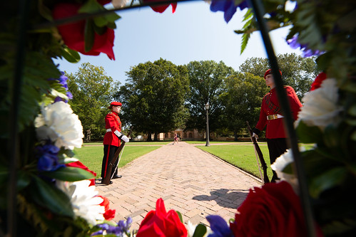 Members of the Queens' Guard stand watch over a memorial honoring the lives, including those of seven William & Mary alumni, that were lost on Sept. 11, 2001.