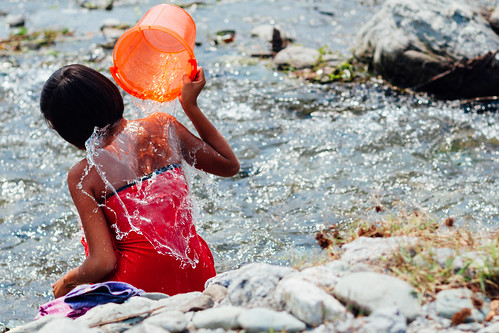 Woman Bathing with Bucket in River, Saw Myanmar