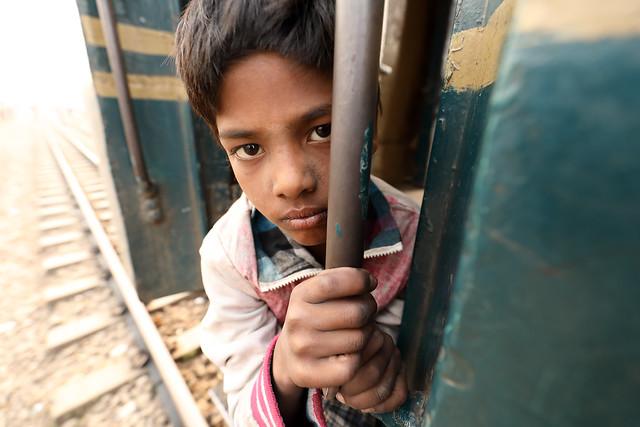 Bangladesh, street boy on a train in Dhaka