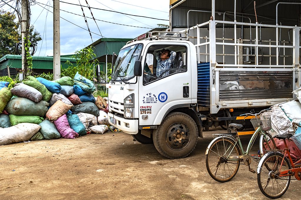 Truck about to leave plastic recycling plant--Ea Kly