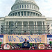 Ronald W. Reagan addressing Constitution Bicentennial gala outside Capitol, w. WE THE PEOPLE backdrop, 1987