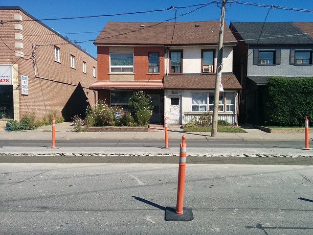 Repairing Dufferin Street south of Dupont #toronto #dufferinstreet #dovercourtvillage #wallaceemerson #dupontstreet #asphalt #black #pylon #orange #repair