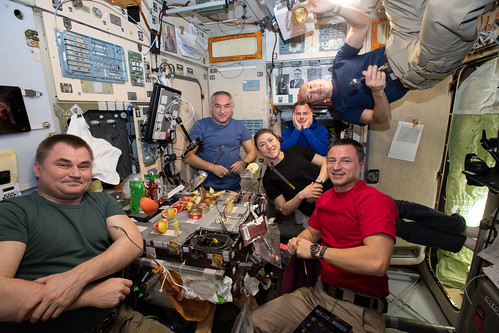 The Expedition 60 crew is gathered together for dinner | by NASA Johnson