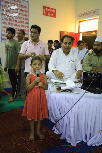 Child devotee presenting a devotional song